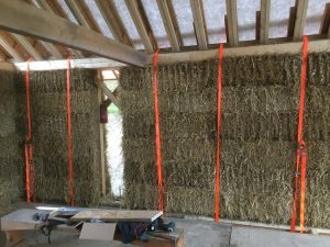 ratchets used to compress straw bale walls